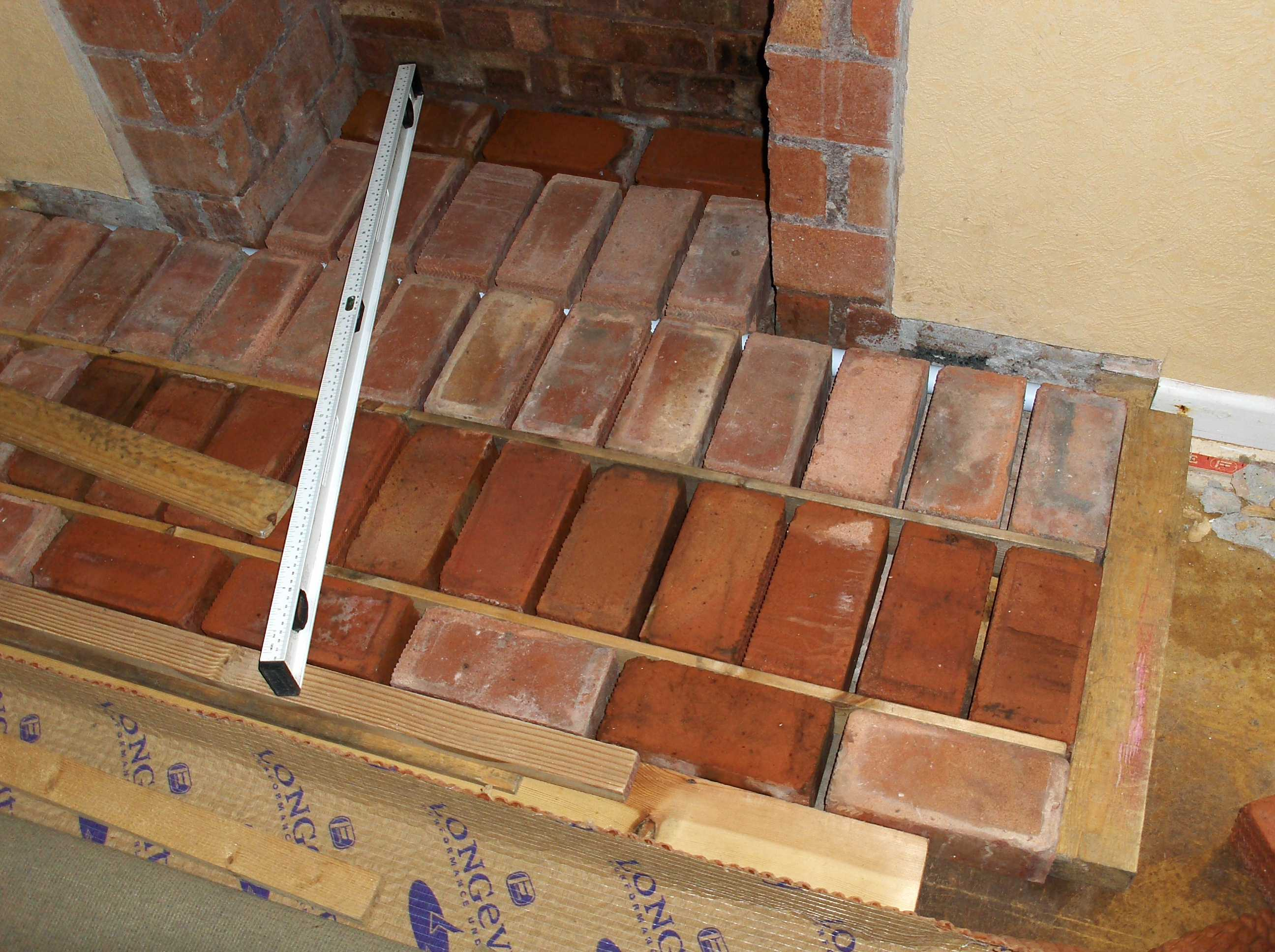 how to clean brick fireplace hearth